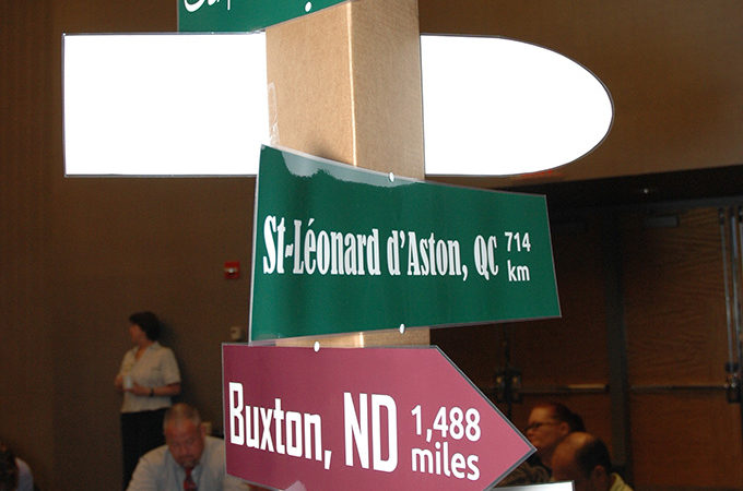 Photo of directional signs pointing to North Dakota and Quebec